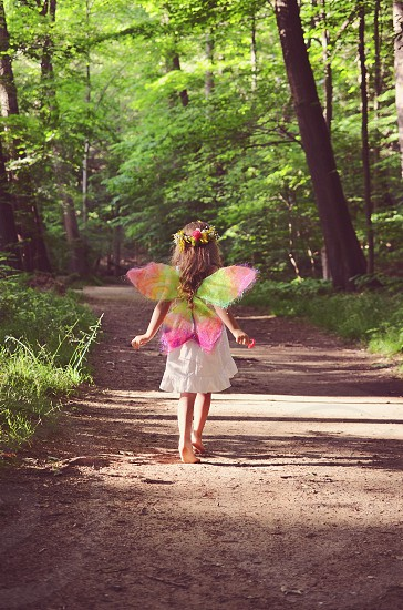 girl in fairy costume in forest photo