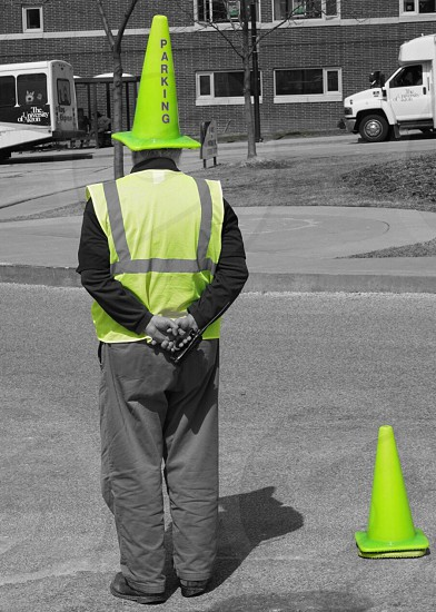 man wearing green traffic cone with parking print photo