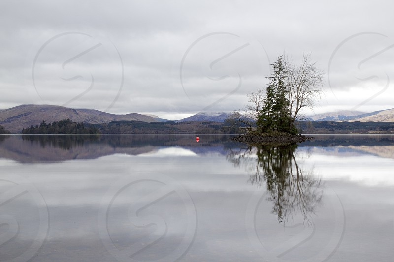 Still spring loch in Scotland photo