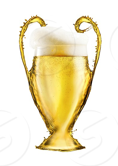 Football yellow cup made from beer isolated on white background. Cup as a symbol or emblem of the UEFA Champions League photo