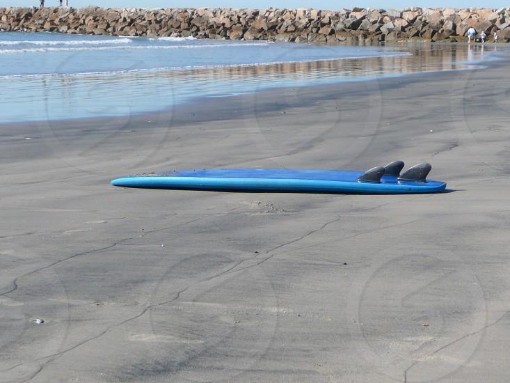 lone blue surfboard photo