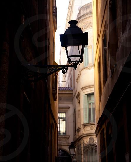 Barcelona gothic barrio streetlight backlight detail photo