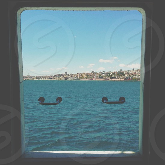 An open ferry window view of the city photo