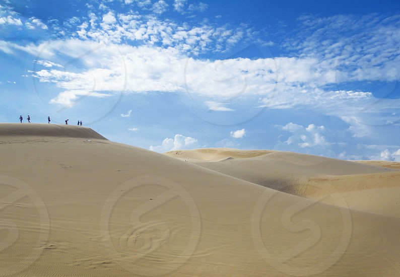 people on a desert photography photo
