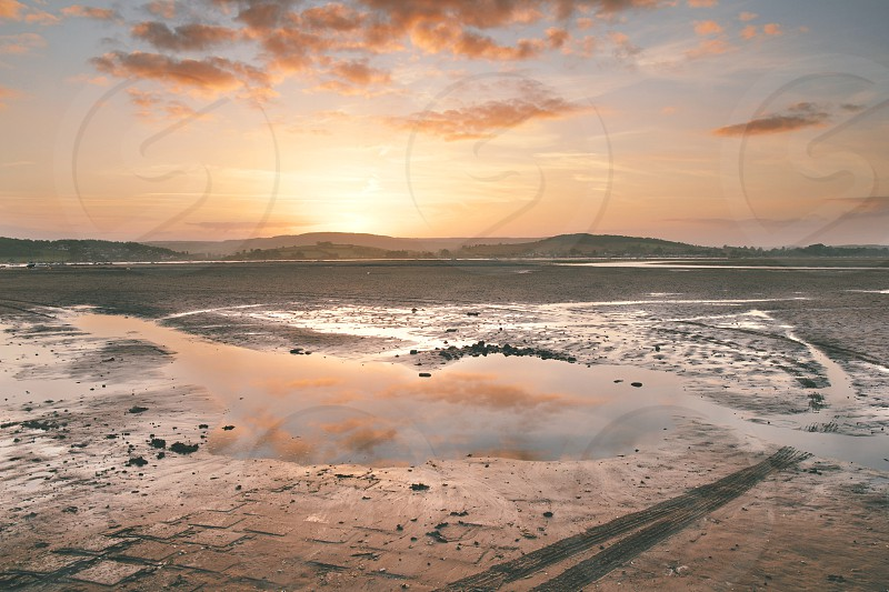 The River Exe is spectacularly lit by a sunset. Taken in Exmouth Devon UK. photo
