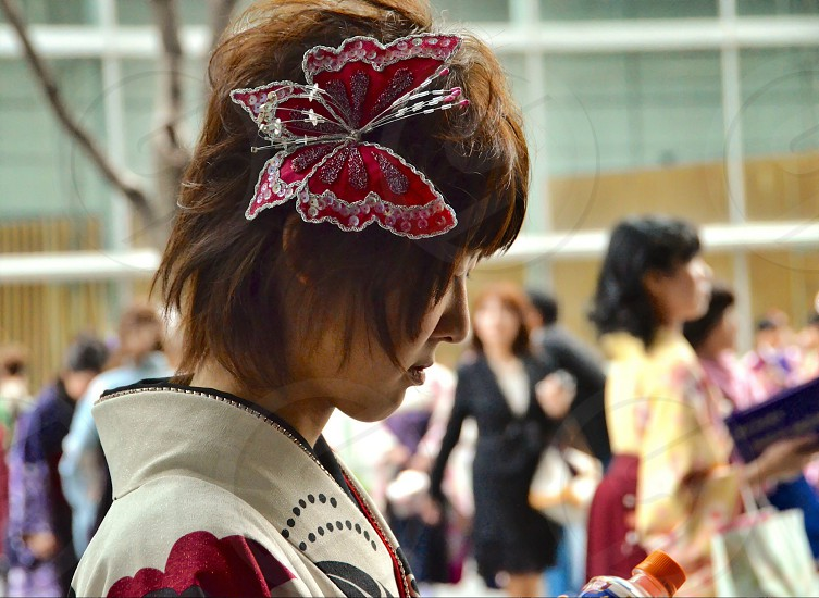 person wearing red and white butterfly head dress photo