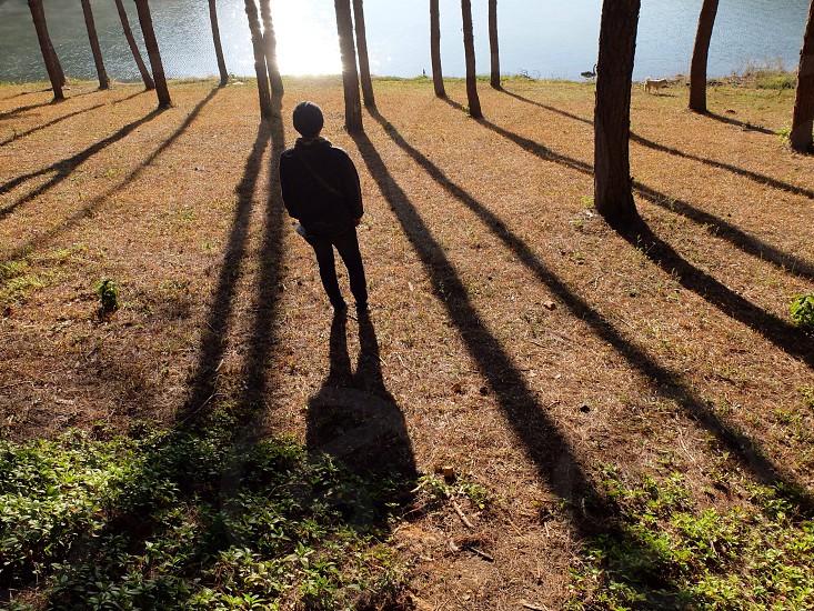man standing on land photo