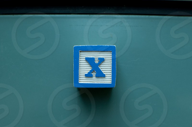X written on colorful toy blocks photo