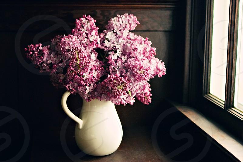 White Ceramic Vase with Pink Flowers photo