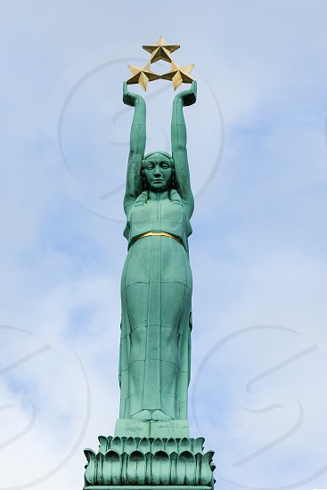 Photo of Milda statue on the top of the Freedom monument in Riga. It's a symbol of the Latvian independence. She holds 3 stars : each of them corresponds to a region of Latvia.  photo