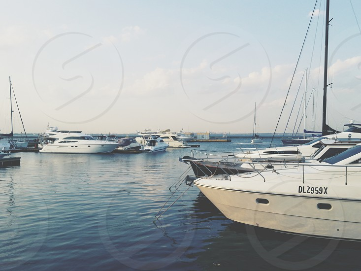 dl2959x white private yacht on body of water photo