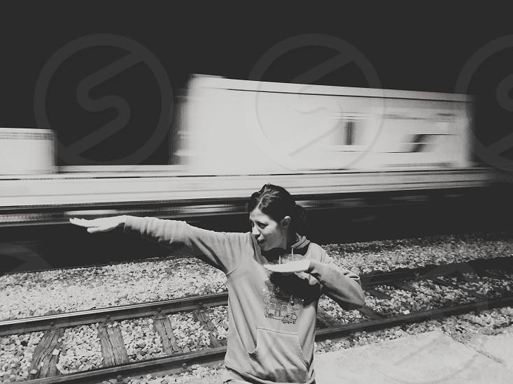 girl train motion black and white photo