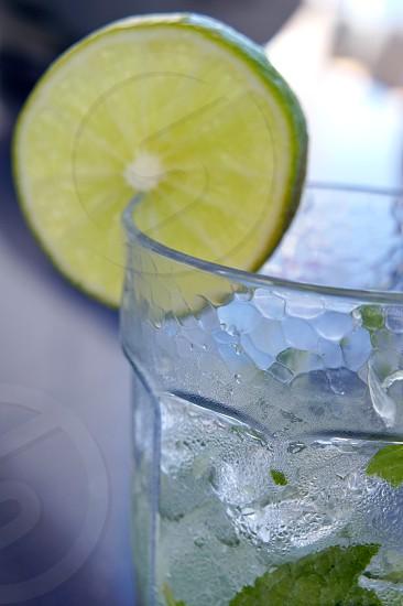 Lime slice in a mojito photo