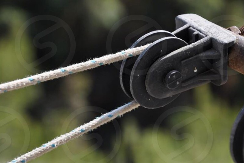black metal pulley with white string photo
