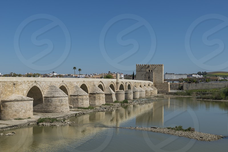 the old bridge over the river in the city cordoba andalusia in spain photo