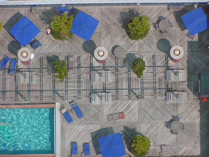 Wooden Pool deck. Umbrellas and pool lounges. Auckland. New Zealand  photo