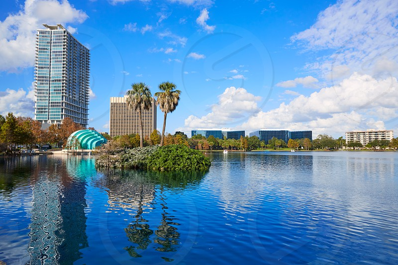Orlando skyline fom lake Eola in Florida USA with palm trees photo