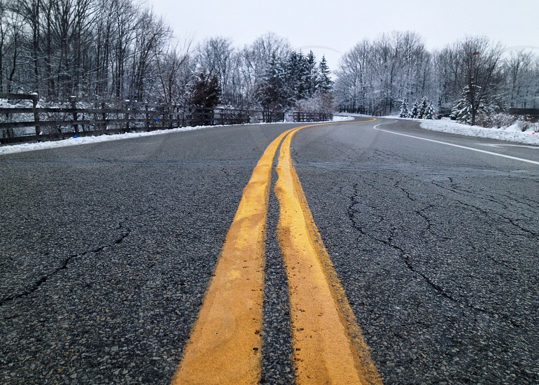 paved road lines  in winter time photo