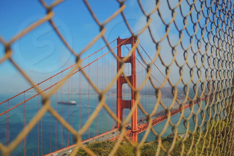 beige metal chain link fence photo