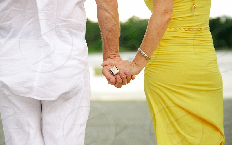 A couple holding hands photo