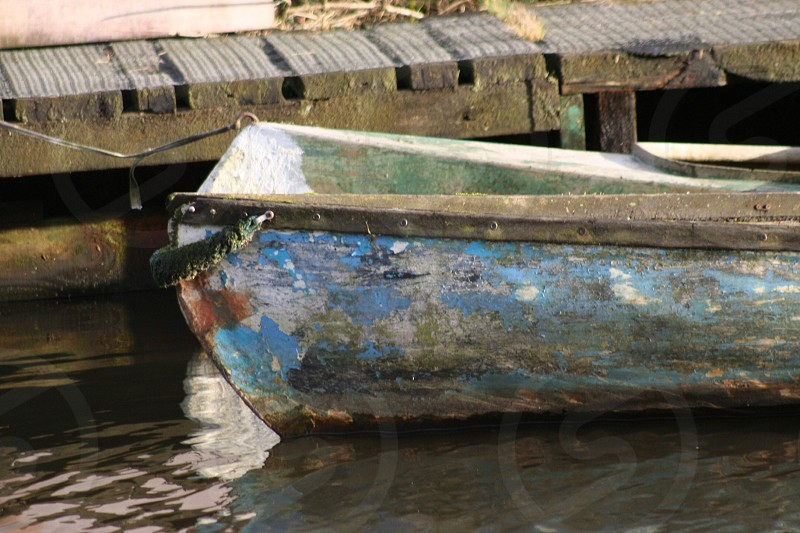 Boat decaying on canal photo