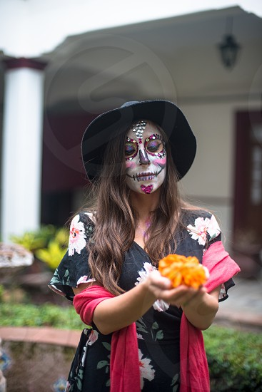 Young woman celebrating Day of the Dead in Mexico  photo