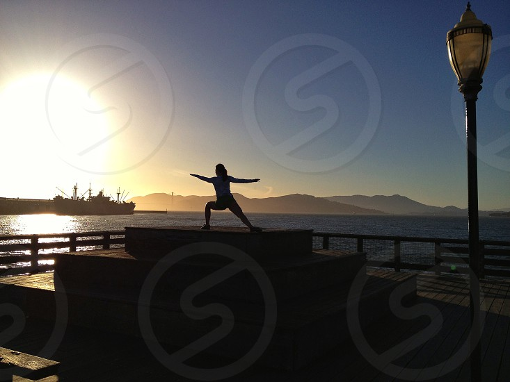 Woman doing yoga on San Francisco pier photo