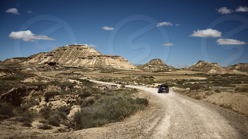 Car in the Bardenas Desert in Spain photo