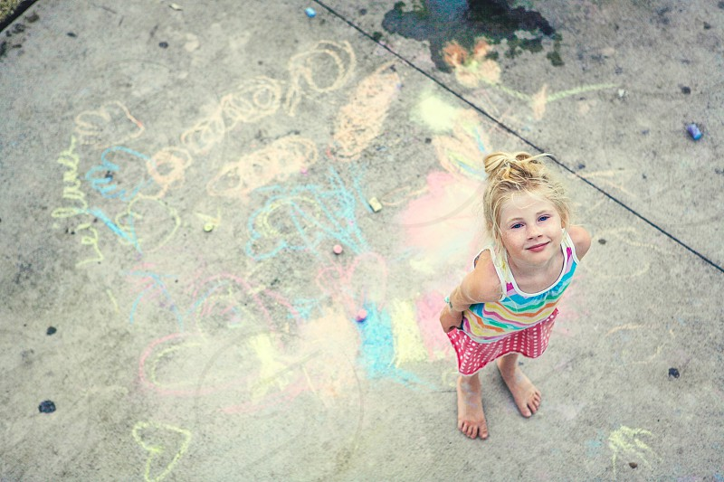 chalk fun summer chalk on sidewalk creative little girl colorful kid child imagination  photo