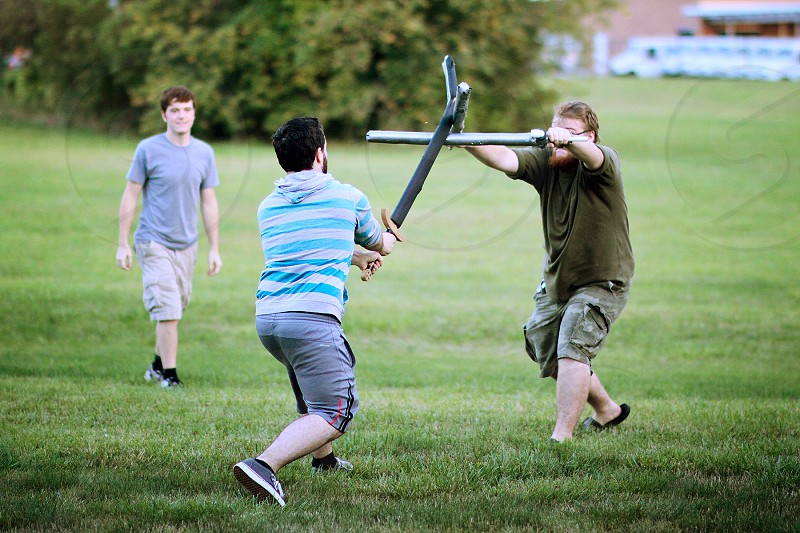 two men playing real life role playing game photo