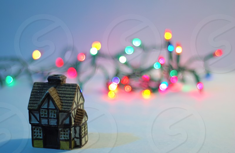 Christmas lights and a miniature building. photo