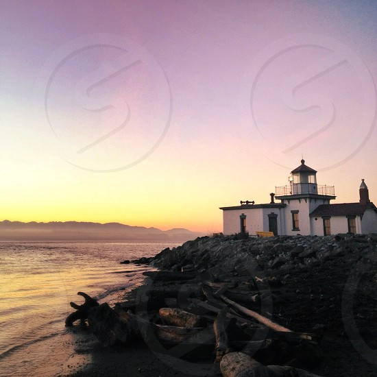 white house and lighthouse photography photo