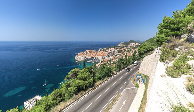 Panoramic view of the Old Town and Old Port of Dubrovnik Croatia  in a sunny summer day photo