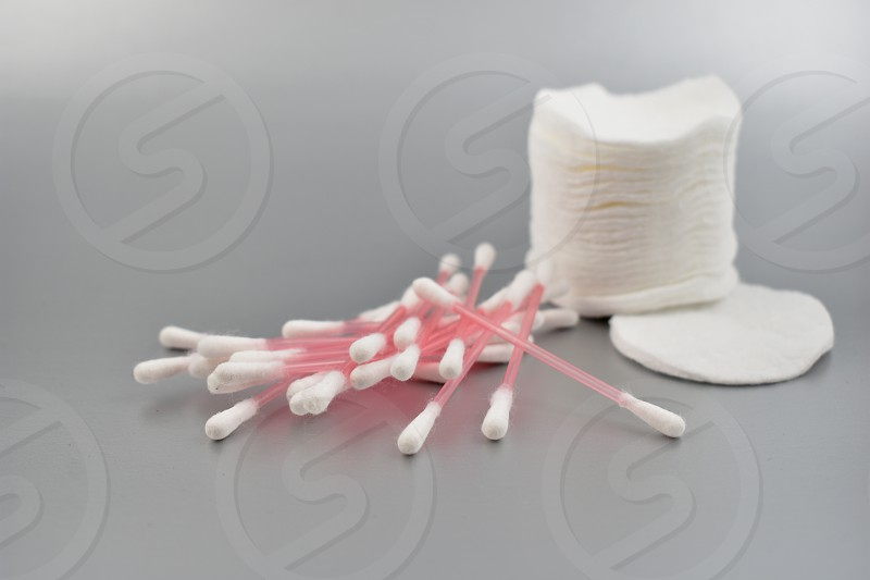 Cotton cosmetic tools. Cotton wool sticks. Plastic Ear Sticks. Cotton wool sticks isolated on a silver backgroud. Cotton pads images photo