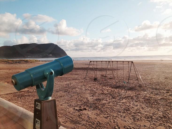 telescope on seashore photograph photo