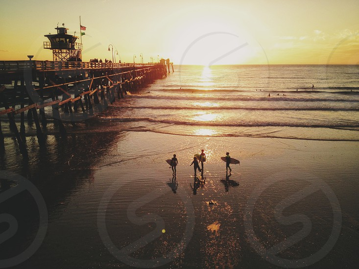 surfers at the beach photo