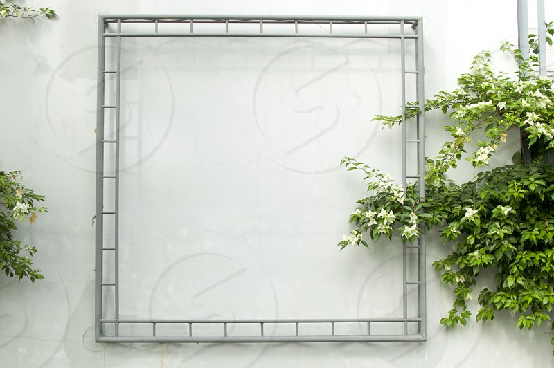 A metal frame in a white wall  photo