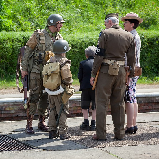 HORSTED KEYNES SUSSEX/UK - MAY 7 :  Southern at War re-enactment day at Horsted Keynes Railway Station in Horsted Keynes Sussex on May 7 2011. Five unidentified people photo