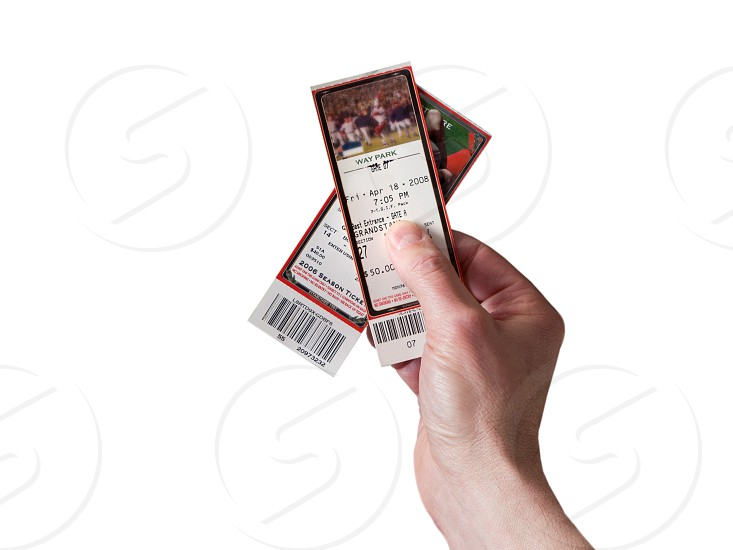 person holding two tickets photo