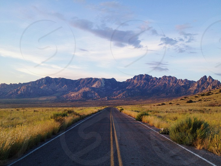 road near mountain photography photo