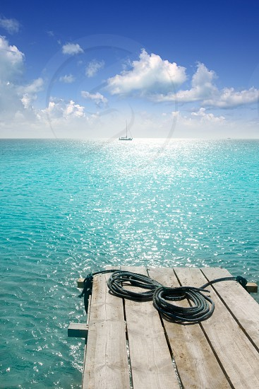 Formentera beach wood pier turquoise balearic Mediterranean paradise sea photo