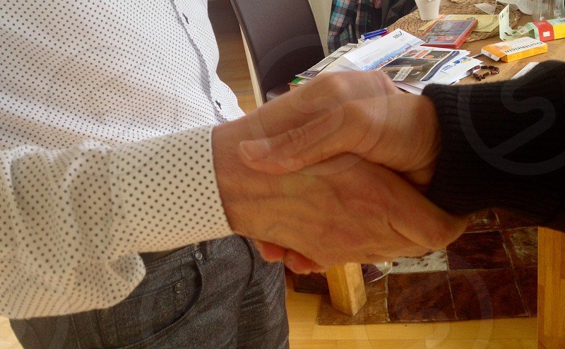 human are giving a handshake photo