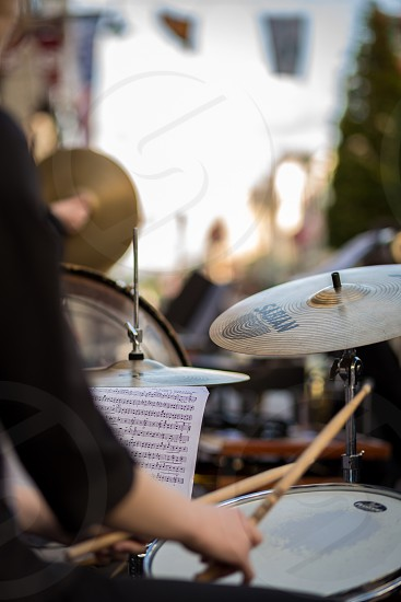 person playing the drums photo