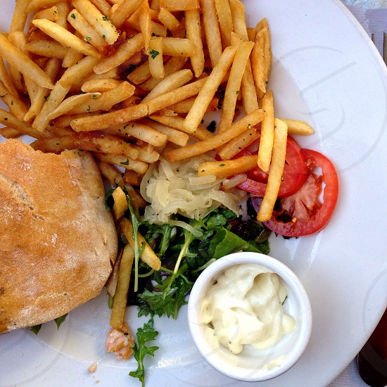 burger bun french fries with tomato food photography  photo