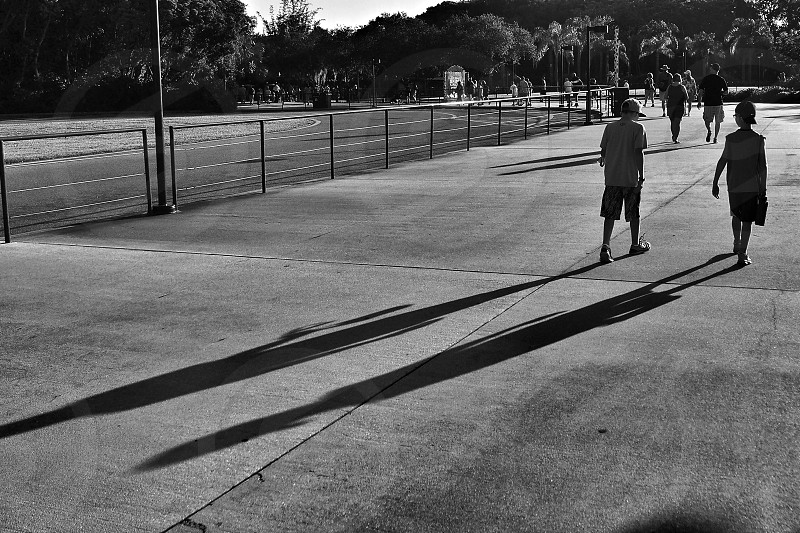 black and white picture of people walking photo