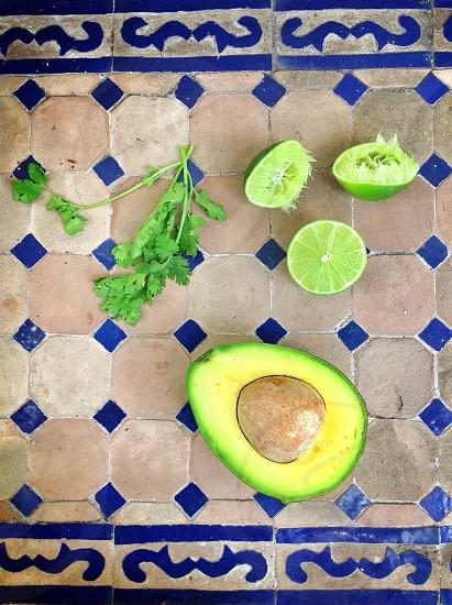 Green is my favorite color. Avocado lime cilantro... guacamole making.  photo