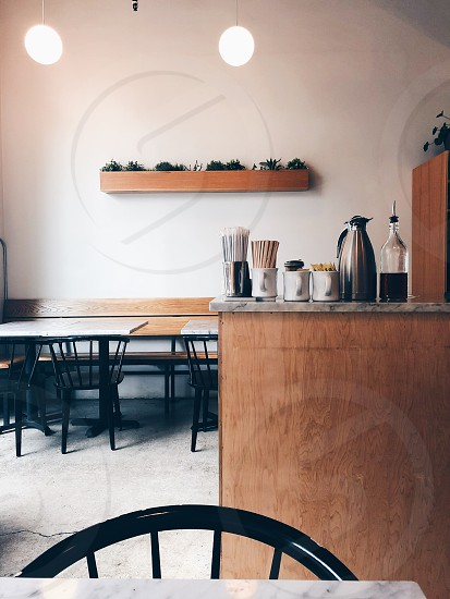Cafe restaurant coffee bar beverage natural light seating tables  photo