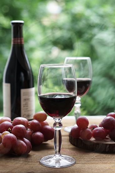 glass and bottle of wine and grape photo