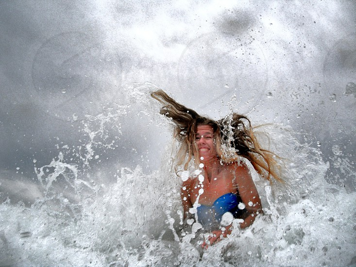 Funny blonde girl in wave photo