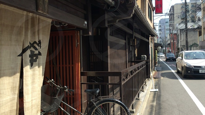 Kyoto city Street in Japan. Japanese Old Classic Long-established stores. Machiya of deep color of the wood has historic stately. photo